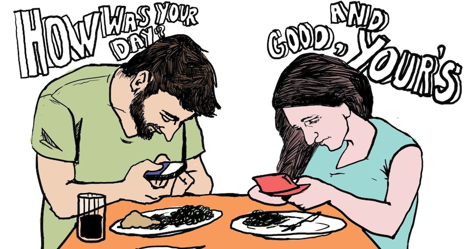 people texting at the table